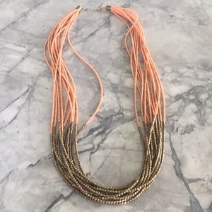 Coral and gold long beaded necklace